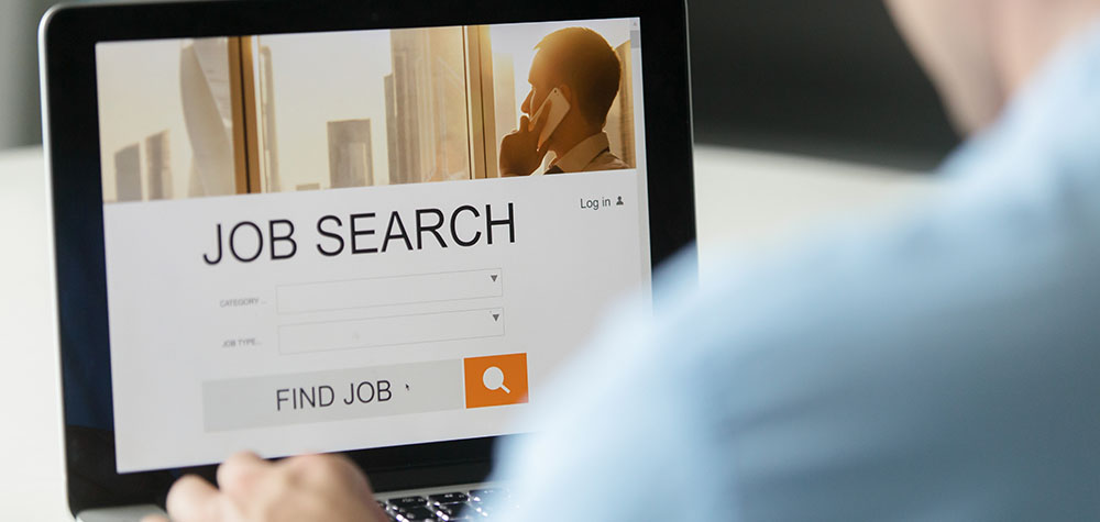 A person looking for jobs on his laptop
